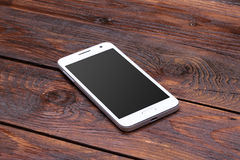 smart-phone-blank-screen-lying-wooden-white-table-55694172